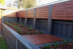 Custom merbau fence extensions and garden bed