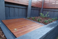Custom merbau fence extensions and garden bed ft. gardenia and liriopes