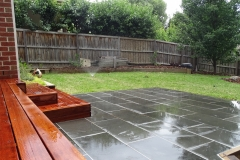 Merbau decking and natural bluestone paving